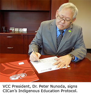 VCC President Dr. Peter Nunoda signs CICan's Indegenous Education Protocol