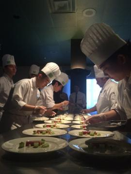Students plating at the Chef's Table - Pop-up Kitchen.