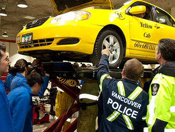 Automotive service technician students teamed up with the taxi inspector and police to perform vigorous safety checks on rebuilt taxis.