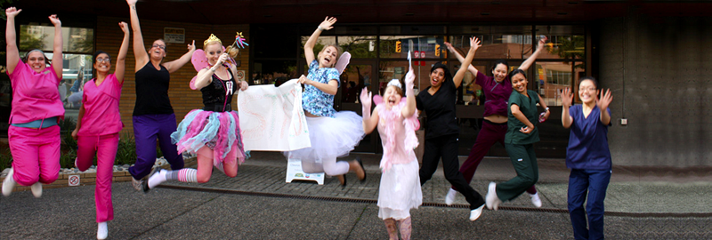 VCC's dental hygiene students jumping together in front of VCC downtown campus.
